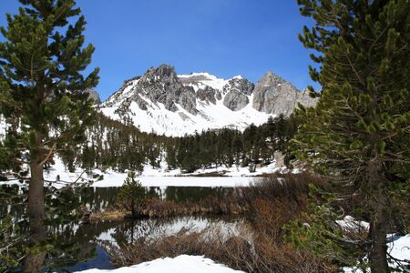 snowy mountain and lake in the Sierra Nevada mountains photo