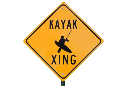 kayak crossing road sign that says kayak xing Stock Photo