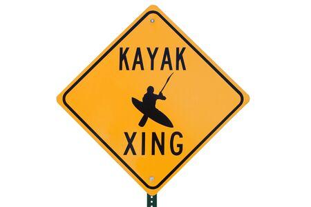 xing: kayak crossing road sign that says kayak xing Stock Photo
