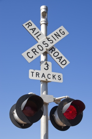 3 tracks railroad crossing sign with blinking red lights Stock Photo - 13796145