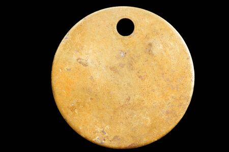 brassy: blank old brass metal tag with black background