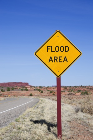 flood area: vertical image of flood area sign in the desert Stock Photo