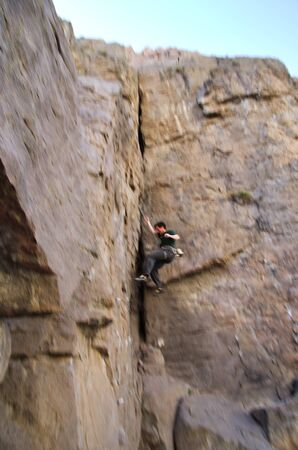 rockclimber: a falling rock climber with motion blur