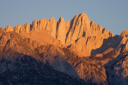 summit of Mount Whitney the highest mountain in the contiguous United States lit up by morning sunrise