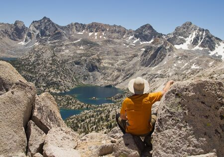 sierras: Man on top of Fin Dome enjoying the Rae Lakes Overlook in the Sierra Nevada mountains