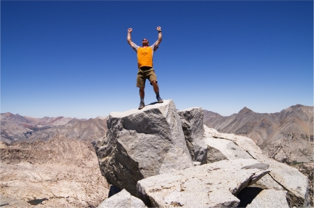 outdoorsman: a man celebrates his success on the summit of Mount Cotter Stock Photo