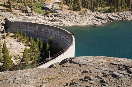 concrete dam creating Waugh Lake reservoir in the California Sierra Nevada