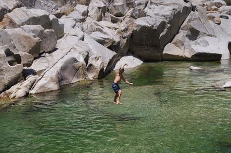 a man slacklining over the Yuba River photo