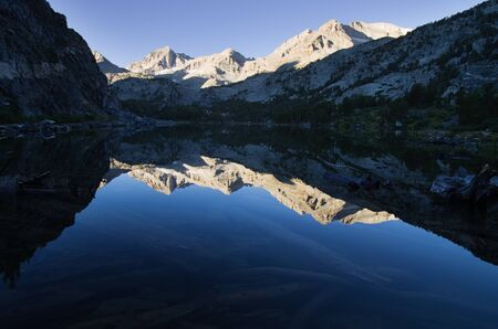 long lake: mountain reflections in Long Lake in Rock Creek of the Sierra Nevada Mountains