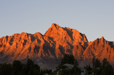 mount humphreys: Mount Humphreys sunset with orange alpenglow from the Humphreys Basin in the Sierra Nevada mountains Stock Photo