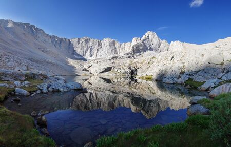 john muir wilderness: Mount Carl Heller reflected in an alpine lake in the Sierra Nevada Mountains of California
