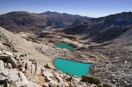 saddlebag: alpine lakes below Mount Conness with milky blue glacial coloring Stock Photo