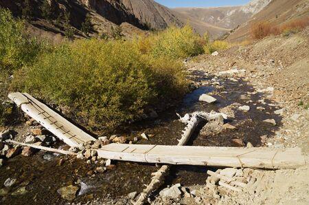 broken log bridge over McGee Creek in the Sierra Nevada Stock Photo - 16003311