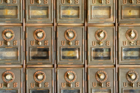 vintage US mail pigeonholes with locked brass doors