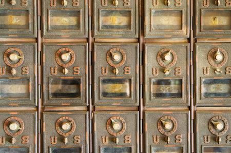 mailroom: vintage US mail pigeonholes with locked brass doors
