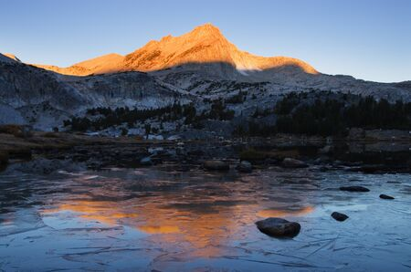 basin mountain: reflection of North Mountain on icy Greenstone Lake