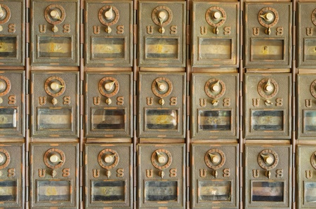 mailroom: old brass US mail pigeonhole mailboxes with combination locks Stock Photo