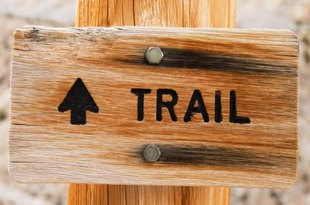 wooden trail sign: wooden trail sign on wood post with arrow