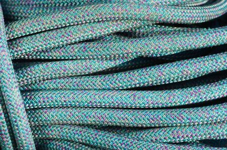 tight focus: coiled up blue rock climbing rope background