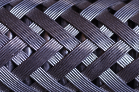 tight focus: macro image of a metal wire braided reinforced hose