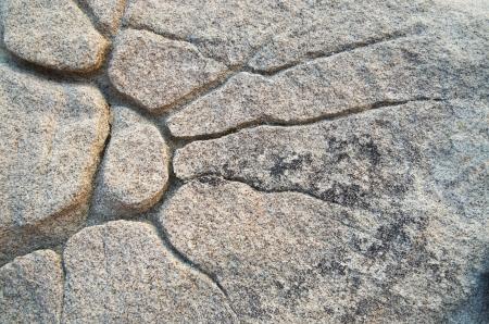 natural sunburst pattern eroded in granite rock Stock Photo - 16766125