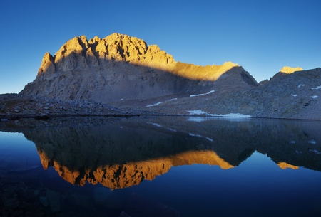 john muir wilderness: last light on Mount Williamson reflected on a lake in Williamson Bowl