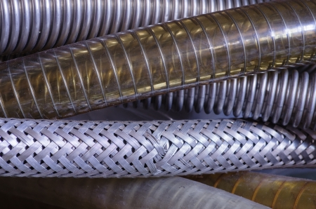 tight focus: close up image of a number of reinforced vacuum hoses