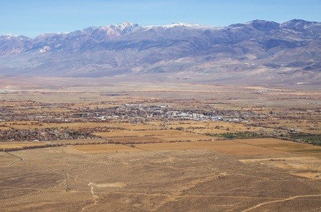 owens valley: the city of Bishop and the White Mountains viewed from above in December Stock Photo