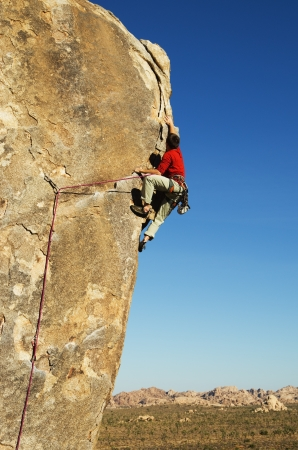 a man lead rock climbing in Joshua Tree National Park
