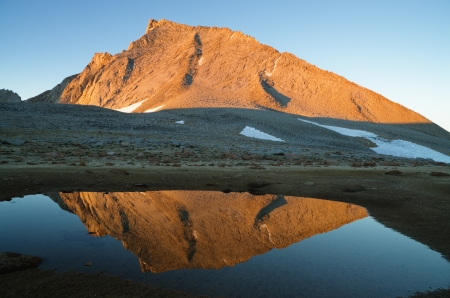 Mount Tyndall lit by morning light reflected in a small pool Stock Photo - 17060959