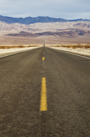 An empty road stretches across Panamint Valley in Death Valley National Park photo