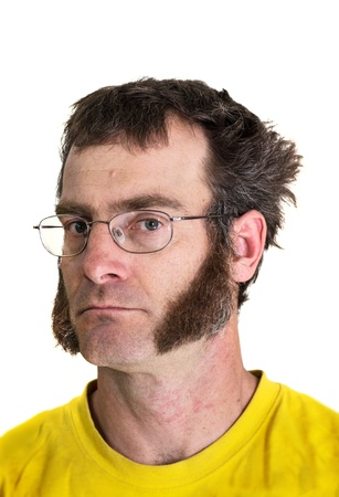 mutton chops: a middle aged man with sideburns and a yellow tshirt Stock Photo