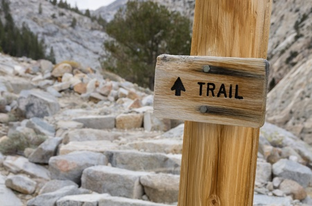 pine creek: wooden trail sign with granite trail in the background