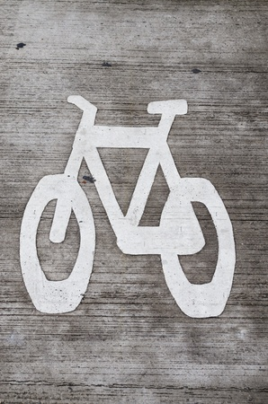 white bike lane stencil on gray concrete roadway Stock Photo - 20436491