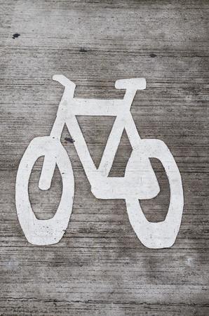 white bike lane stencil on gray concrete roadway Stock Photo - 20436491