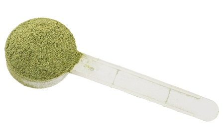 chlorophyll: scoop of green nutritional drink powder on white background Stock Photo