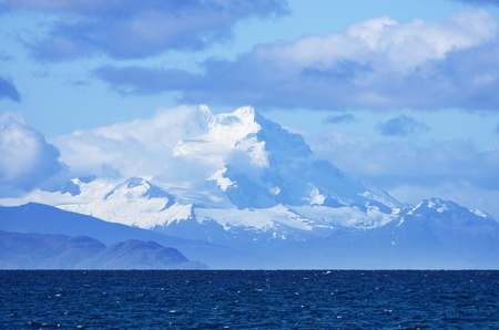 sarmiento: distant Mount Sarmiento looms above the Strait of Magellan in Patagonia Chile Stock Photo