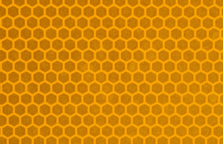 macro image of yellow reflective sign surface with hexagonal pattern Stok Fotoğraf