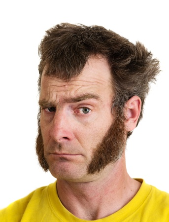 a man with large sideburns looks at the camera with one eyebrow raised Stock Photo - 21621764