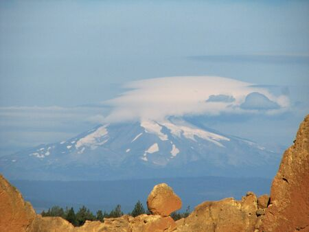 lenticular: Mount Jefferson with a lenticular cloud seen through Asterisk pass, Smith Rock, Oregon