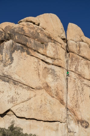 a rock climbing man leading Double Cross rock climb in Joshua Tree National Park Stock Photo - 21703340