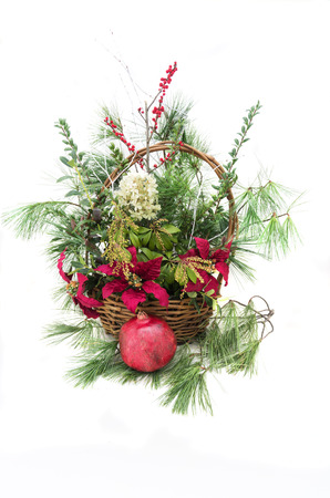 Christmas arrangement in a basket with greenery and flowers Stock Photo - 23193342