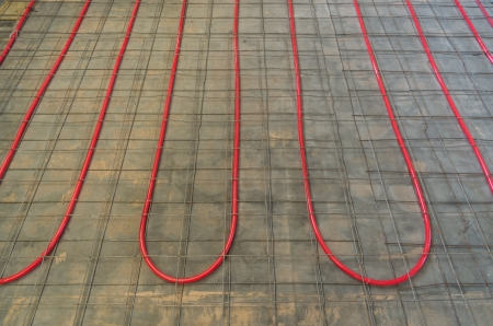 PEX tubing on a floor for hydronic heating with reinforcing mesh ready for concrete