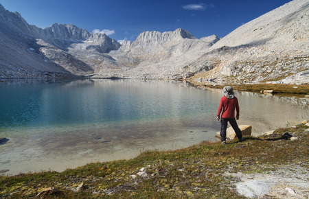 man standing on sierra mountain lake shore looking at landscape Stock Photo - 23224544