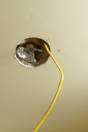 hole in drywall for a ceiling light installation during a home remodel Stock Photo - 24203380