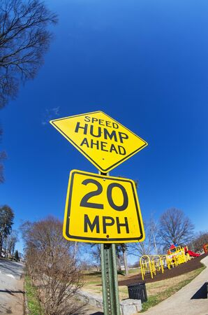 fisheye image of speed hump ahead sign with playground Stock Photo - 24203391