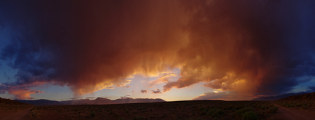 dramatic desert sunset panorama from the volcanic tableland near Bishop California Stock Photo - 24203394
