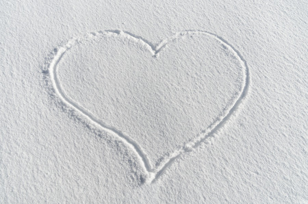 heart shape drawing in fresh white snow Stock Photo - 24317005