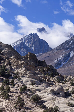 Mount Humphreys pokes through the clouds above the buttermilks near Bishop California Stock Photo - 24317066