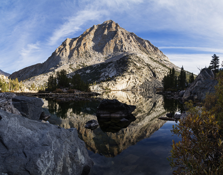 pine creek: reflection of mountain in Pine Lake in the Sierra Nevada mountains Stock Photo
